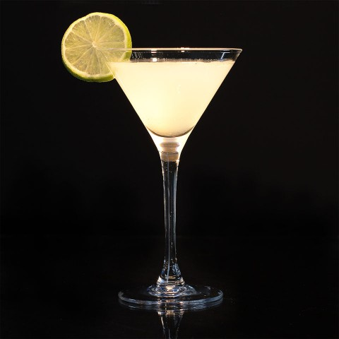 The Ninotchka Cocktail garnished with lime wheel (Коктейль Ниночка)