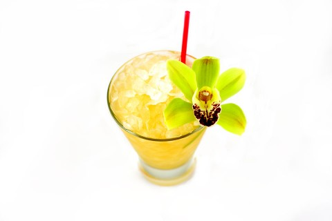 The Supreme Mai-Tai Cocktail garnished with otchid (     )
