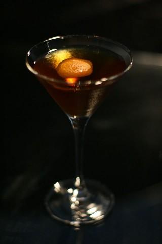The Hanky Panky Cocktail garnished with an orange peel (Коктейль Фокус-Покус украшенный кожурой апельсина)