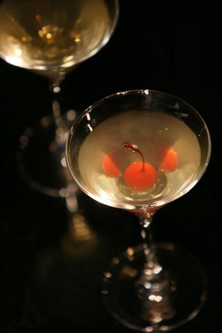 The Yellow Daisy Cocktail garnished with red maraschino cherry (Коктейль Желтая Ромашка украшенный красной мараскиновой вишенкой)