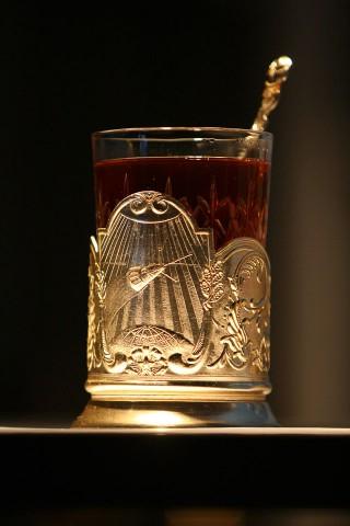 The glass of russian tea in vintage tea cup holder (Стакан чая в советском подстаканнике)