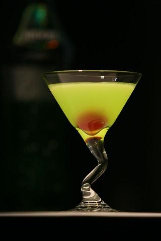 The Japanese Slipper Cocktail (beauty green cocktail garnished with red maraschino cherry) (Коктейль Japanese Slipper (красивый зеленый коктейль украшенный красной мараскиновой вишней))