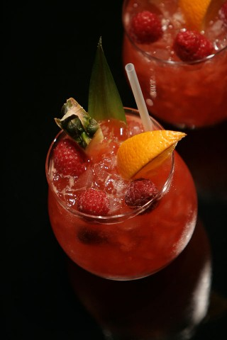 Gin Punch with fruit and berry garnish (       )