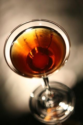 The Rob Roy Cocktail garnished with red maraschino cherry (Коктейль Роб Рой украшенный красной мараскиновой вишней)