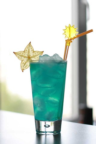 The Blue Lagoon Cocktail garnished with star-fruit (    )