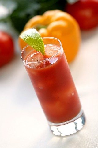 The Bloody Mary Cocktail garnished with lime wedge (     )