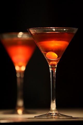 The Special Manhattan Cocktail garnish with red maraschino cherry (Коктейль Манхэттен Особый, украшенный мараскиновой вишней)