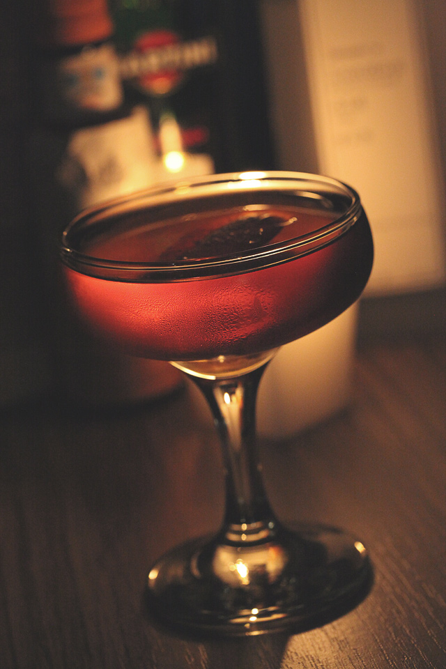 The Martinez Cocktail in candle light | ScienceOfDrink.com