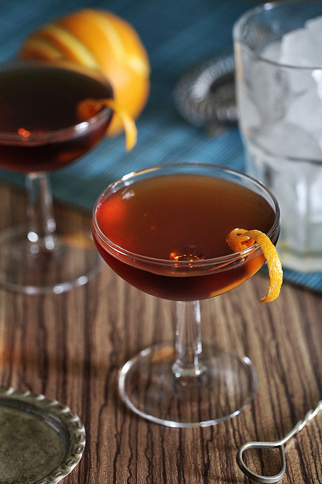 The Martinez Cocktail served in a beauty coupe garnished with an orange twist | ScienceOfDrink.com