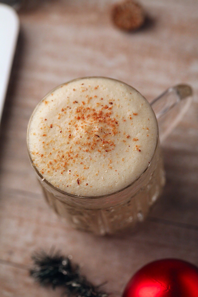 Fluffy and thick top of real Cooked Egg Nog grated with nutmeg