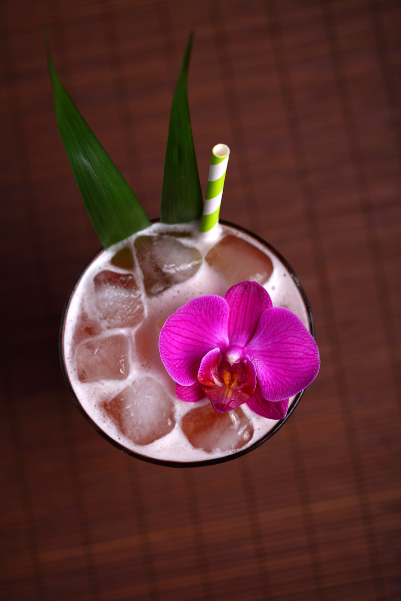 Beauty tiki-cocktail (Jungle Bird) garnished with orchid | ScienceOfDrink.com