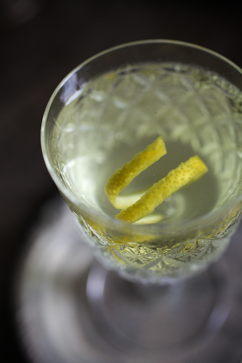Alaska Cocktail garnished with a lemon twist | ScienceOfDrink.com